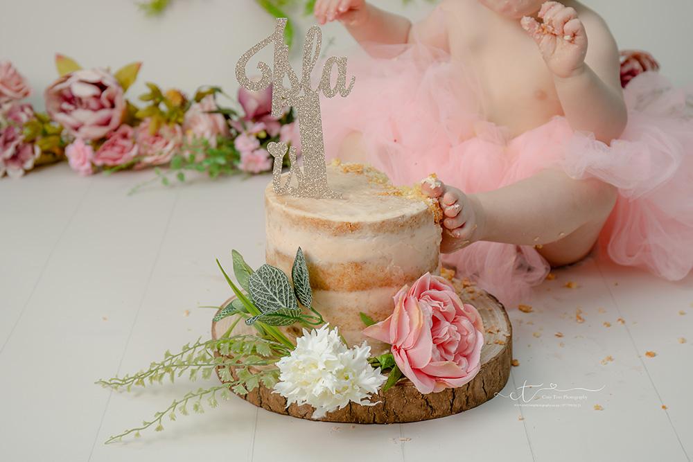 Horsham Baby girl puts her foot on cake