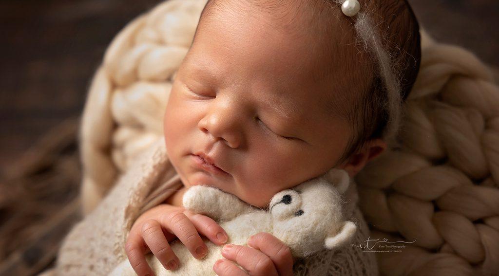 sweet newborn photos of baby cuddling teddy