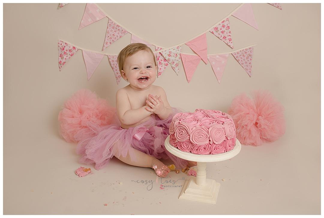 baby girl enjoys her cake smash in west sussex