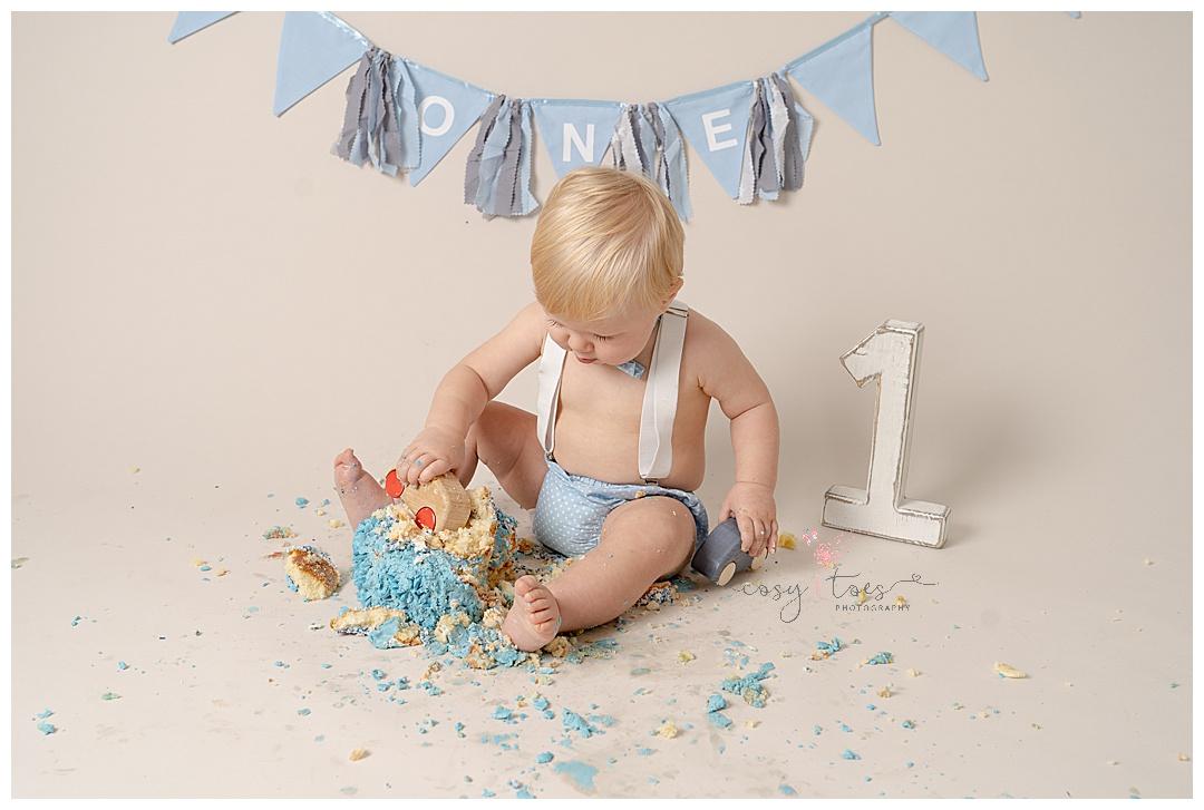 baby boys smashed cake with car at his Horsham Cake Smash