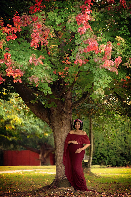 pregnant mum to be leaning against tree in Pregnancy photos in Haywards Heath